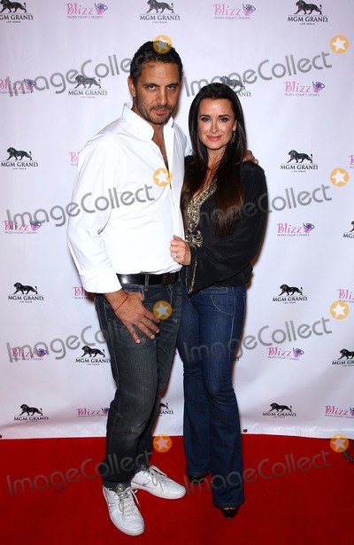 Mauricio Umansky, Kyle Richards Photo - 14 January 2012 - Las Vegas, Nevada - Mauricio Umansky, Kyle Richards.  The Real Housewives of Beverly Hills walk the red carpet in celebration of the grand opening of the newest Blizz Frozen Yogurt at the MGM Grand  Resort Hotel and Casino.  Photo Credit: MJT/AdMedia