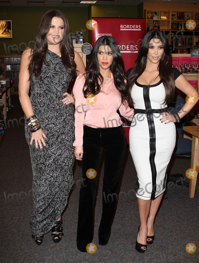 Khloe Kardashian, Kourtney Kardashian, Kim Kardashian, Khloe' Kardashian, Khloe  Kardashian Photo - 2 December 2010 - Century City, CA - Khloe Kardashian, Kourtney Kardashian and Kim Kardashian. Kardashian sisters sign copies of their new book 'Kardashian Konfidential' held At Borders Book Store. Photo: Kevan Brooks/AdMedia