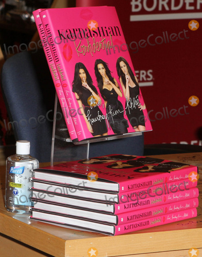 Photo - 2 December 2010 - Century City, CA - . Kardashian sisters sign copies of their new book 'Kardashian Konfidential' held At Borders Book Store. Photo: Kevan Brooks/AdMedia