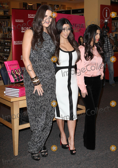 Khloe Kardashian, Kim Kardashian, Kourtney Kardashian, Khloe' Kardashian, Khloe  Kardashian Photo - 2 December 2010 - Century City, CA - Khloe Kardashian, Kim Kardashian, Kourtney Kardashian. Kardashian sisters sign copies of their new book 'Kardashian Konfidential' held At Borders Book Store. Photo: Kevan Brooks/AdMedia