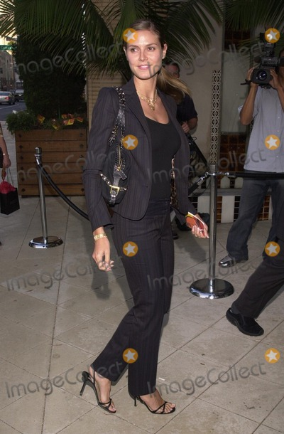 "Heidi Klum, Robert Evans Photo - Heidi Klum at the celebrity gala honoring Producer Robert Evans for his new film ""The Kid Stays In The Picture"" at Barney's Greengrass, Barney's New York, Beverly Hills, Ca. 07-18-02"
