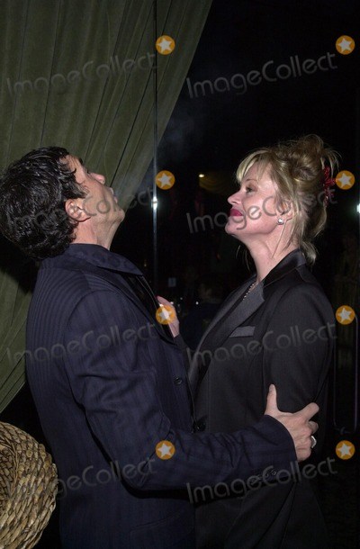 Antonio Banderas, Melanie Griffith, Stella Adler Photo - Antonio Banderas sneaks a puff off Melanie Griffith's cigarette at the first annual Stella Adler awards, Highlands Nightclub, Hollywood, 06-01-02