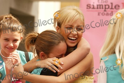 Nicole Richie Photo - Nicole Richie and crying fan at the Simple Life 2 Dog Fashion Show, Hollywood and Highland, Hollywood, CA 05-27-04