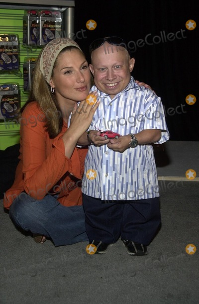 "Daisy Fuentes Photo - Daisy Fuentes and Verne ""Mini-Me"" Troyer at a press conference to launch the ""ZipZaps"" micro radio controlled car, at the Petersen Automotive Museum, Los Angeles, CA 09-25-02"