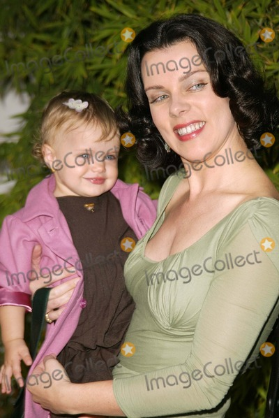 Debi Mazar Photo - Debi Mazar and daughter Evelyn at the Grand Opening of the First Stella McCartney Store in Los Angeles, West Hollywood, CA 09-28-03