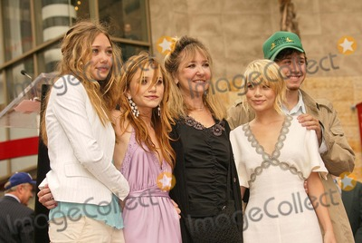 Ashley Olsen Photo - Mary-Kate and Ashley Olsen with family members at the Olsen's induct