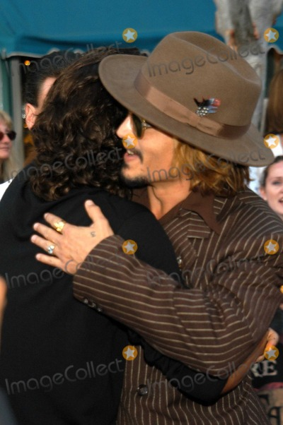 "Johnny Depp, Orlando Bloom Photo - Johnny Depp and Orlando Bloom at The World Premiere of ""Pirates of the Caribbean: The Curse of the Black Pearl"", Disneyland, Anaheim, Calif., 06-28-03"