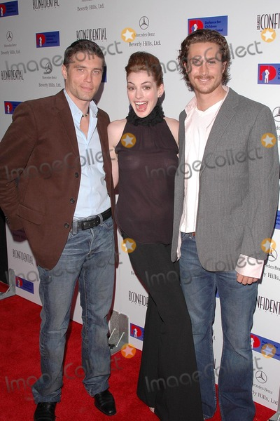 Anson Mount, Anne Hathaway, Oliver Hudson Photo - Anson Mount, Anne Hathaway and Oliver Hudson at the Defense For Children International Fundraiser at the Beverly Hills Mercedes Benz Showroom, Beverly Hills, CA. 05-12-04