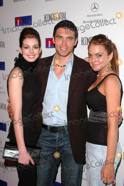 Anne Hathaway, Anson Mount, Lindsay Lohan Photo - Anne Hathaway, Anson Mount and Lindsay Lohan at the Defense For Children International Fundraiser at the Beverly Hills Mercedes Benz Showroom, Beverly Hills, CA. 05-12-04