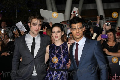 "Kristen Stewart, Robert Pattinson, Taylor Lautner Photo - LOS ANGELES - NOV 14:  Robert Pattinson, Kristen Stewart, Taylor Lautner arrives at the ""Twilight: Breaking Dawn Part 1"" World Premiere at Nokia Theater at LA LIve on November 14, 2011 in Los Angeles, CA"