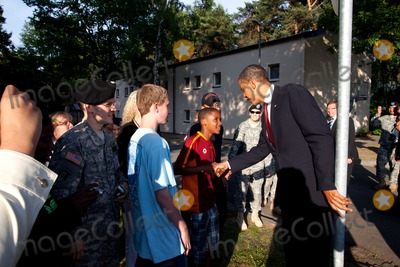 Barack Obama, President Barack Obama Photo - Landstuhl, Germany - June 5, 2009 -- United States President Barack Obama stops to shake hands with people outside Landstuhl Regional Medical Center 