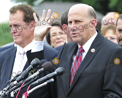 Photo - United States Representative Louie Gohmert (Republican of Texas) makes remarks after the first Tea Party Caucus meeting at the U.S. Capitol in Washington, D.C. on Wednesday, July 21, 2010.  U.S. Representative Phil Gingrey (Republican of Georgia) is at left.