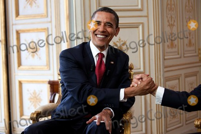 Barack Obama, Nicolas Sarkozy, President Barack Obama Photo - Caen, France - June 6, 2009 -- United States President Barack Obama shakes hands with President Nicolas Sarkozy of France during a bilateral meeting