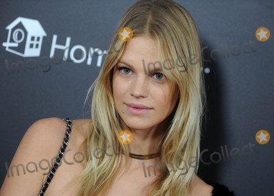 """Photo - Photo by: Dennis Van Tine/starmaxinc.comSTAR MAX2017ALL RIGHTS RESERVEDTelephone/Fax: (212) 995-11963/13/17Nadine Leopold at the premiere of """"Beauty And The Beast"""" in New York City."""