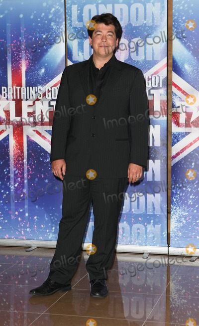 "Photo - Michael McIntyre poses for photographers during a press launch for the fifth season of ""Britain's Got Talent"", held at at The Mayfair Hotel. London, UK. 04/13/11."