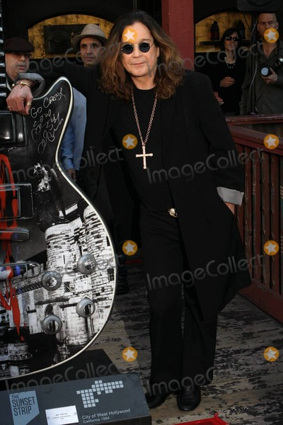 The Ceremonies, Les Paul, Ozzy Osbourne Photo - Rock legend Ozzy Osbourne appears at the House of Blues to sign the one-of-a-kind 10-foot tall fiberglass Gibson Les Paul model art guitar designed in his honor as part of Gibson GuitarTown on the Sunset Strip. The ceremony also celebrated the launch of the second leg of Ozzy's U.S. Arena tour. Los Angeles, CA. 1/10/11.