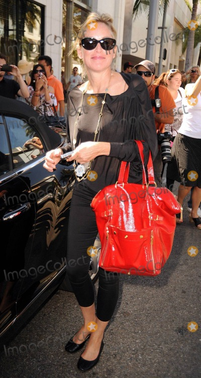 Sharon Stone Photo - Sharon Stone smiles for photographers as she gets in a day of shopping on Rodeo Drive. Beverly Hills, CA. 8/17/10.