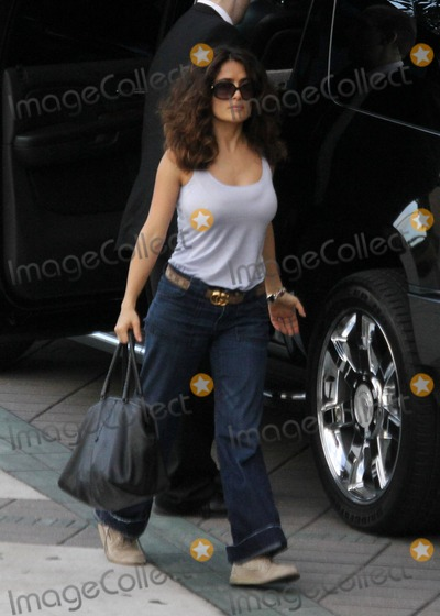 Salma Hayek, Tank Photo - EXCLUSIVE!! Salma Hayek arrives back at her Miami hotel wearing a white tank top and jeans after a day out with daughter Valentina.  Miami, FL. 4/22/11