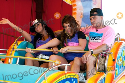 "Deena Cortese, DJ Pauly D, Nicole ""Snooki"" Polizzi, Nicole 'Snooki' Polizzi, Nicole Snooki Polizzi, Paul DelVecchio, Snooki, The Shore, ""Snooki"" Polizzi, Pauly D, NICOLE, SNOOKI Photo - Nicole ""Snooki"" Polizzi, Deena Cortese and DJ Pauly D (Paul Delvecchio) take a break from working at the Shore Store to ride a carnival ride while filming episodes for the MTV show ""Jersey Shore."" Seaside Heights, NJ. 7/7/11."
