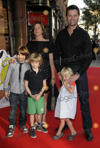 George Clarke Photo - London. UK .  George Clark and family at the premiere of  The Itch of the Golden Nit. Vue West End, Leicester Square.  29th June 2011. Can Nguyen/Landmark Media.