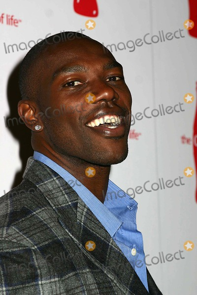 "Terrell Owens, Dita Von Teese, Terrel Owens Photo - Coca Cola's ""Coke Side of Life"" Launch Party Capitale , New York City 03-30-2006 Photo: Mitchelle Levy-rangefindrs-Globe Photos Inc. 2006 Dita Von Teese Terrell Owens"
