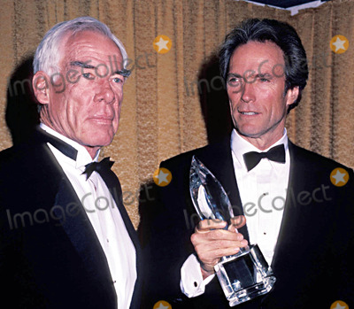 Clint Eastwood, Lee Marvin Photo - Clint Eastwood with Lee Marvin at the People's Choice Awards 3/1985 #13598 Photo by Phil Roach/ipol/Globe Photos, Inc.