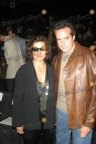Bianca Jagger, David Copperfield Photo - Mercedes-benz Fashion Week Luca Luca Spring 2004 Collection Bryant Park, New York City 09/14/2003 Photo by John Barrett/Globe Photos Inc 2003 Bianca Jagger and David Copperfield