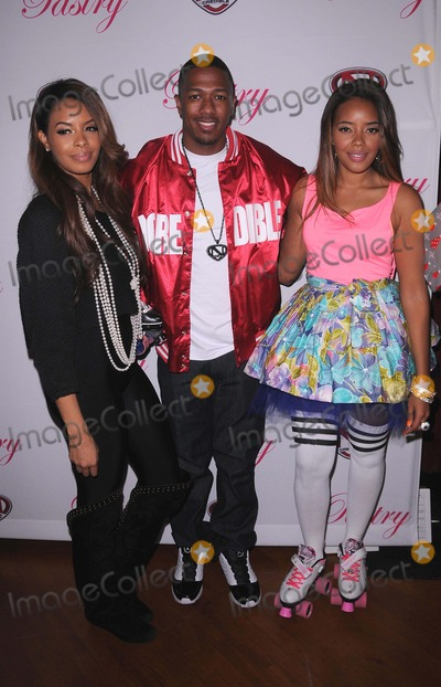 Angela Simmons, Nick Cannon, Vanessa Simmons Photo - Launch Party of Pastry Lite Shoe Collection at the Moonlight Rollerway in Glendale, CA 12/9/11 Photo by Scott Kirkland-Globe Photos   2011 Angela Simmons, Nick Cannon and Vanessa Simmons