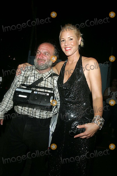 "Maria Bello, Radioman, ""Radioman"", 'Radioman' Photo - Guests Arrive at the Lever House Restaurant For the Afterparty For the World Trade Center Film Premiere East 53rd Street 08-03-2006 Photos by Rick Mackler Rangefinder-Globe Photos Inc.2006 Maria Bello with Radioman"