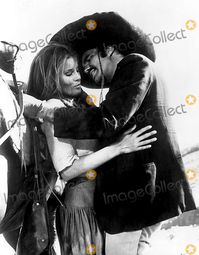 "Burt Reynolds, Raquel Welch Photo - Raquel Welch and Burt Reynolds in a Scene From ""100 Rifles"". Supplied by Smp/Globe Photos, Inc."