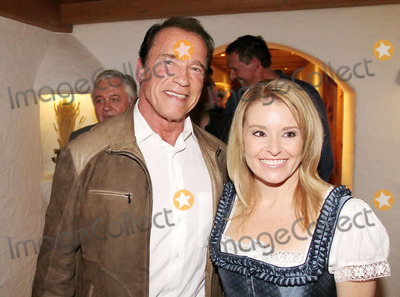 Arnold Schwarzenegger Photo - Arnold Schwarzenegger erstmals mit Freundin Heather Milligan bei der 23 Weisswurstparty beim Stanglwirt in Going am 24.01.2014  Credit: Kirschner/face to face