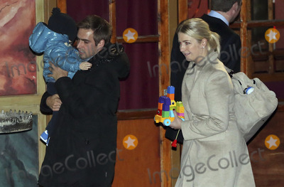 Alfons Schuhbeck, Bayern Munich, philipp lahm Photo - Philipp Lahm mit Frau Claudia und Sohn Julian attending the FC Bayern Munich Weihnachtsfeier/Christmas Party at the Theatro of Alfons_Schuhbeck in Munich, 08.12.2013. Credit: Nickels/face to face
