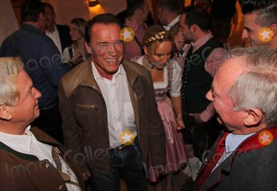 Arnold Schwarzenegger Photo - Arnold Schwarzenegger begruesst Balthasar Hauser und Karl Schranz auf der 23 Weisswurstparty beim Stanglwirt in Going am 24.01.2014  Credit: Kirschner/face to face