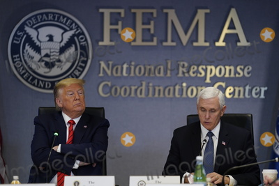 Donald Trump, Mike Pence Photo - United States President Donald J. Trump attends a teleconference with governors at the Federal Emergency Management Agency headquarters, Thursday, March 19, 2020, in Washington, DC. US Vice President Mike Pence is at right.