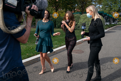 White House Photo - White House Director of Strategic Communications and Assistant to the President Alyssa Farah, center, walks outside the West Wing in Washington, D.C., U.S., on Friday, October 9, 2020.