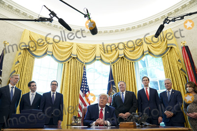 Brian Hooks, Melania Trump, TI, JARED KUSHNER, White House, The White, President Trump, Mike Pompeo Photo - United States President Donald J. Trump speaks on a conference call with leaders of Israel and Sudan and to members of the media about a Sudan-Israel peace agreement at the White House in Washington, DC, on Friday, October 23, 2020. President Trump announced that Israel and Sudan will start to normalize ties. From left to right: Brian Hook, former United States Special Representative for Iran and Senior Advisor to the Secretary of State;  Avraham Berkowitz, Assistant to the President and Special Representative for International Negotiations; US Secretary of the Treasury Steven T. Mnuchin; the President; US Secretary of State Mike Pompeo; Jared Kushner, Assistant to the President and Senior Advisor; United States National Security Advisor Robert C. O'Brien, unidentified.Credit: Leigh Vogel / Pool via CNP/AdMedia