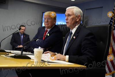 Donald Trump, Mike Pence Photo - United States President Donald J. Trump listens as US Vice President Mike Pence speaks during a teleconference with governors at the Federal Emergency Management Agency headquarters, Thursday, March 19, 2020, in Washington, DC.Credit: Evan Vucci / Pool via CNP/AdMedia