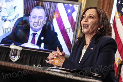 White House, The White, Kamala Harris Photo - United States Vice President Kamala Harris, right, speaks during a virtual bilateral meeting with President Alejandro Giammattei of Guatemala, on screen at left, in the Vice President's Ceremonial Office in the Eisenhower Executive Office Building on the White House campus, about the migration crisis on April 26, 2021, in Washington, DC. Credit: Oliver Contreras / Pool via CNP/AdMedia