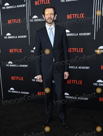 "Adam Godley Photo - 12 February 2019 - Hollywood, California - Adam Godley. Netflix's ""The Umbrella Academy"" Los Angeles Premiere held at the Arclight Hollywood. Photo Credit: Birdie Thompson/AdMedia"