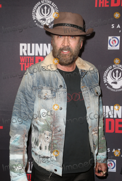 """Nicolas Cage, Nicolas Cazalé Photo - 16 September 2019 - Beverly Hills, California - Nicolas Cage. Premiere Of Quiver Distribution's """"Running With The Devil held at Writers Guild Theater. Photo Credit: FSadou/AdMedia"""