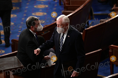 Joe Biden, Steny Hoyer Photo - United States House Majority Leader Steny Hoyer (Democrat of Maryland), right, wears a protective mask during a joint session of Congress to count the Electoral College votes of the 2020 presidential election in the House Chamber in Washington, D.C., U.S., on Wednesday, Jan. 6, 2021. Congress is meeting to certify Joe Biden as the winner of the 2020 presidential election, with scores of Republican lawmakers preparing to challenge the tally in a number of states during what is normally a largely ceremonial event. Credit: Erin Scott / Pool via CNP/AdMedia