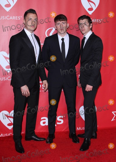 Alex Turner, Arctic Monkeys, Bob Dylan, Jamie Cook, Matt Helders Photo - 6 February 2015 - Los Angeles, California - Matt Helders, Jamie Cook, and Alex Turner of 'Arctic Monkeys'. 2015 MusiCares Person Of The Year Gala Honoring Bob Dylan held at the Los Angeles Convention Center. Photo Credit: AdMedia