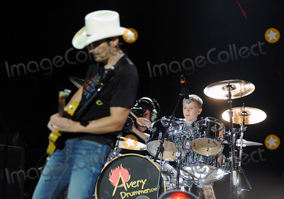 """Avery Molek, Brad Paisley Photo - 01 June 2013 - Burgettstown, PA - Country music artist BRAD PAISLEY performs with 6 year old drummer AVERY MOLEK on a stop on his """"Beat This Summer Tour"""" held at the First Niagara Pavilion.  Photo Credit: Jason L Nelson/AdMedia"""