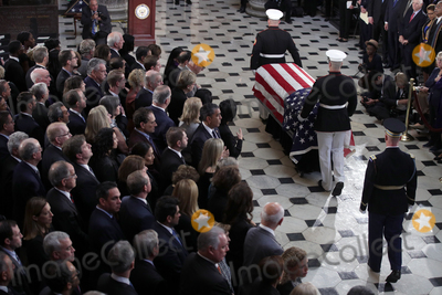 """Elijah Cummings, Alex Wong Photo - The flag-draped casket of United States Representative Elijah Cummings (Democrat of Maryland) is escorted by a honor guard during a memorial service at the Statuary Hall of the U.S. Capitol October 24, 2019 in Washington, DC. Rep. Cummings passed away on October 17, 2019 at the age of 68 from """"complications concerning longstanding health challenges.""""Credit: Alex Wong / Pool via CNP/AdMedia"""