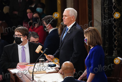 Joe Biden, Nancy Pelosi, Representative Nancy Pelosi, The Unit, Mike Pence Photo - Speaker of the United States House of Representatives Nancy Pelosi (Democrat of California) and US Vice President Mike Pence preside over the Electoral College vote certification for President-elect Joe Biden, during a joint session of Congress at the U.S. Capitol in Washington, DC on Wednesday, January 6, 2021. Credit: Kevin Dietsch / Pool via CNP/AdMedia