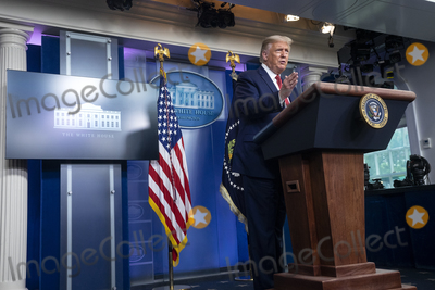 Usher, White House, The White Photo - United States President Donald J. Trump speaks during a news conference in the James S. Brady Press Briefing Room at the White House in Washington D.C., U.S. on Monday, August 10, 2020.  Trump was abruptly ushered out of the briefing room by Secret Service after shots were reportedly fired in the area.  Credit: Stefani Reynolds / CNP/AdMedia