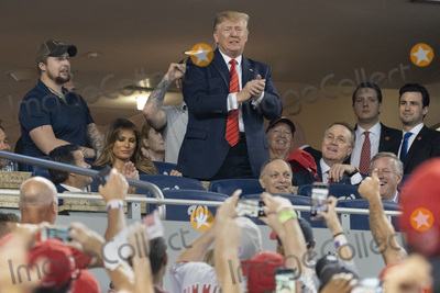 Donald Trump, Melania Trump, TI, Mark Meadows, Kevin Brady Photo - United States President Donald J. Trump participates in a moment to salute the military during game five of the World Series at Nationals Park in Washington DC on October 27, 2019. The Washington Nationals and Houston Astros are tied at two games going into tonight's game. Those also pictured include US Representative Andy Biggs (Republican of Arizona), US Representative Kevin Brady (Republican of Texas), US Senator David Perdue (Republican of Georgia), and US Representative Mark Meadows (Republican of North Carolina). Credit: Chris Kleponis / Pool via CNP/AdMedia