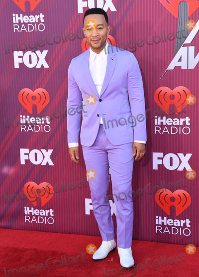 John Legend Photo - 14 March 2019 - Los Angeles, California - John Legend. 2019 iHeart Radio Music Awards Arrivals held at Microsoft Theater. Photo Credit: Birdie Thompson/AdMedia