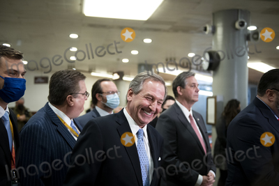 Photo - Defense lawyer for former President Donald J. Trump Michael van der Veen arrives to offer remarks to reporters after the U.S. Senate voted 57-43 to acquit former President Donald J. Trump on an impeachment charge of inciting the attack on the U.S. Capitol on January 6, 202, at the U.S. Capitol in Washington, DC, Saturday, February 13, 2021. Credit: Rod Lamkey / CNP/AdMedia