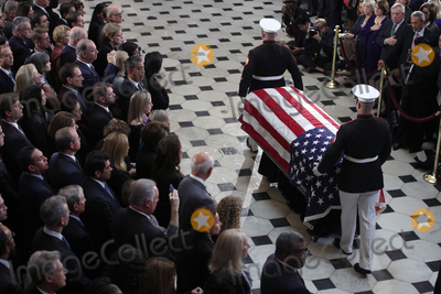 "Elijah Cummings, Alex Wong Photo - The flag-draped casket of United States Representative Elijah Cummings (Democrat of Maryland) is escorted by a honor guard during a memorial service at the Statuary Hall of the U.S. Capitol October 24, 2019 in Washington, DC. Rep. Cummings passed away on October 17, 2019 at the age of 68 from ""complications concerning longstanding health challenges.""